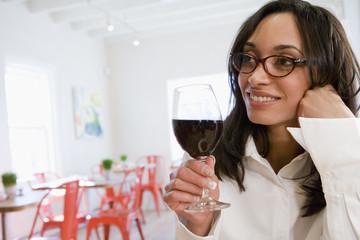 Mixed race woman enjoying wind in cafe
