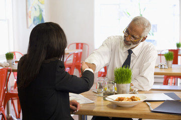 African businessman having lunch with co-worker