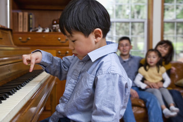 Korean boy playing piano
