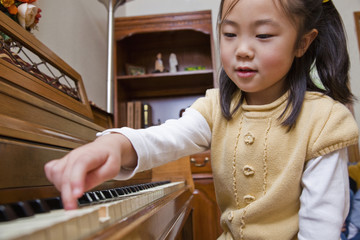 Korean girl playing piano