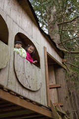 Korean children playing in tree house