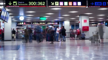 People hurrying in the Barajas T1 airport. TimeLapse movie.