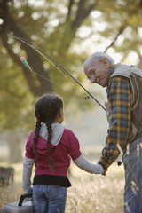Hispanic man going fishing with granddaughter