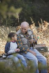 Hispanic man going fishing with granddaughter