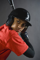 Mixed race baseball player ready to bat