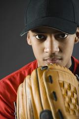 Mixed race baseball player looking serious