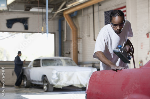 Workers in auto body shop