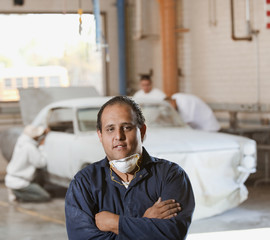 Hispanic man in auto body shop