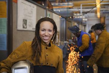 African welder smiling