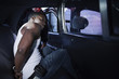 African man being placed in backseat of police car