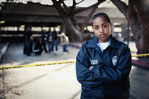 African policewoman standing outside crime scene