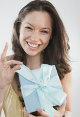 Mixed race woman holding gift