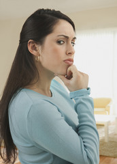 Worried mixed race woman