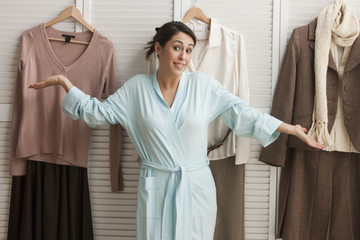 Mixed race woman deciding what to wear