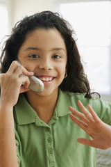 Hispanic girl talking on cell phone