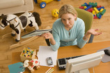 Hispanic woman gesturing at desk surrounded by toys