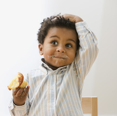African toddler eating cupcake