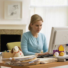 Hispanic woman using computer in home office