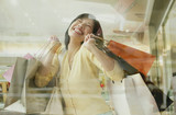 Happy Filipino woman holding shopping bags