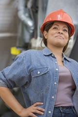 Smiling Hispanic woman wearing hard hat