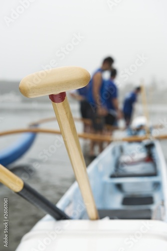 Sea kayak racing team prepare their boat