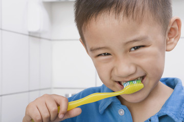 Chinese boy brushing teeth