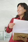 Chinese businesswoman holding documents