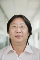 Chinese man wearing eyeglasses