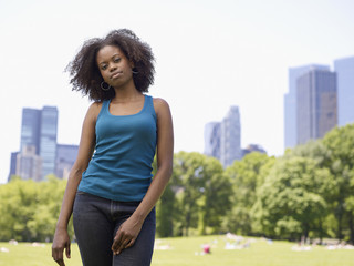 African woman standing in park