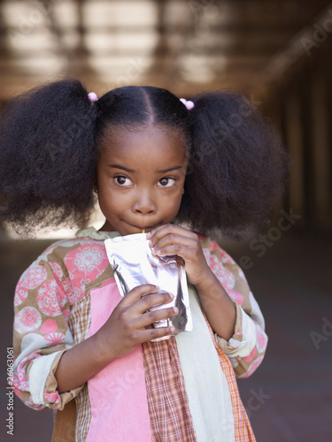 African girl drinking juice