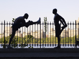 African men stretching on railing