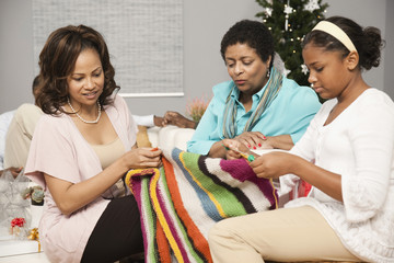 Multi-generation women knitting