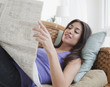 Hispanic woman reading newspaper