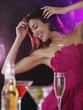 Hispanic woman dancing at nightclub