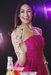 Hispanic woman holding champagne flute
