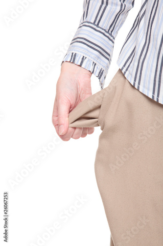 Poor - woman standing with turned out empty pockets