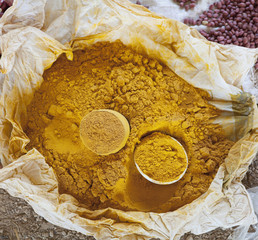 Close up of large bag of curry powder