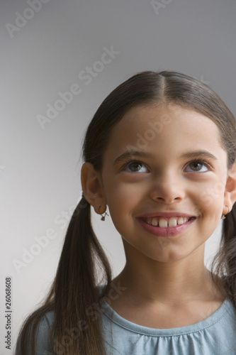 Hispanic girl looking up and smiling