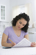 Hispanic woman completing tax forms