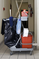 Cleaning service trolley parked in the storeroom corridor