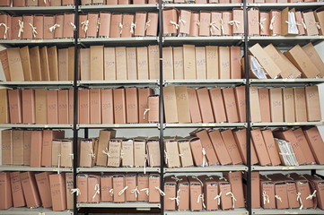 Office archive with many folders on metal shelves