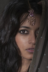 Indian woman wearing jewel headpiece