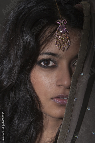 Indian woman wearing jewel headpiece
