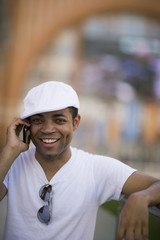 Mixed race man talking on cell phone