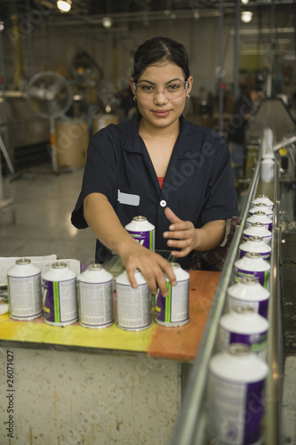 Hispanic woman working in manufacturing plant