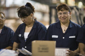 Hispanic women working in manufacturing plant