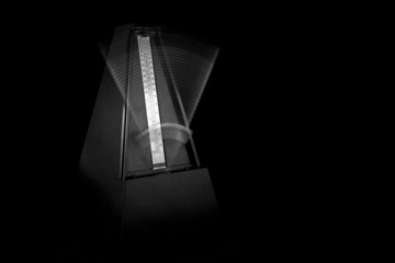 Metronome Ticking with Black Background