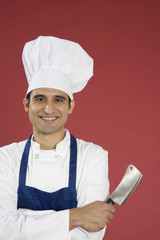 Hispanic chef holding cleaver