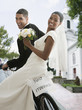 Bride and groom on bicycle with 'Just Married' sign