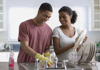 Couple washing dishes
